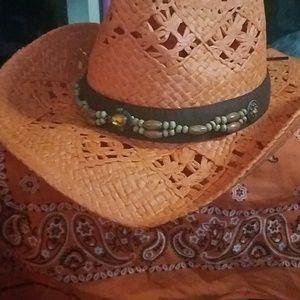 A orange cowgirl hat
